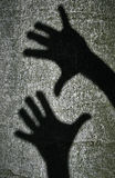 Two shadows hands Stock Image