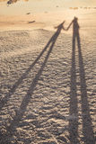 Two shadows - son and father by El Teide vulcan, sea of sand and rocks, Tenerife Stock Photography