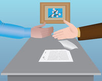 Two shaking hands after signing a contract Stock Photos