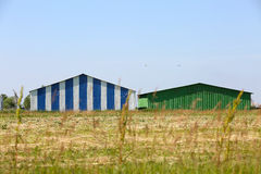 Two sheds in the field. Air sheds in the middle of the field Royalty Free Stock Image