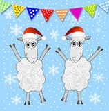 Two sheep and festive garland Stock Photo
