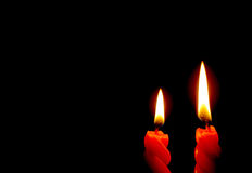 Two Shining Red Candles Isolated On the Dark Background Royalty Free Stock Images