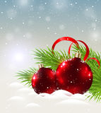 Two shining red decorations in snow Royalty Free Stock Photography