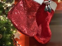 Two shiny christmas socks waiting their gift time stock images