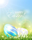 Two shiny Easter eggs in the grass Stock Image