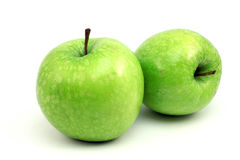 Two shiny green apple Royalty Free Stock Images