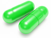 Two shiny green pills (medical capsules) Royalty Free Stock Photo