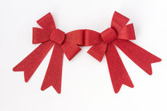 Two shiny red holiday bows Royalty Free Stock Image