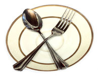 Two shiny spoons on a plate Stock Image