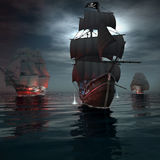Two ship sailing after a pirate ship Stock Photos