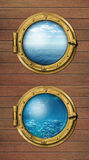 Two ship windows with ocean surface and underwater deep stock photo