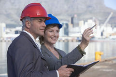 Two shipping engineers taking notes Stock Photos