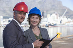 Two shipping engineers taking notes Royalty Free Stock Image