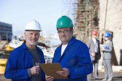 Two shipping engineers taking notes Royalty Free Stock Photography