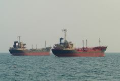 Two ships at anchor Stock Photos
