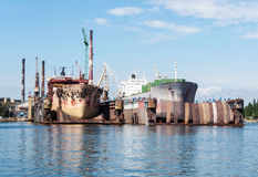 Two ships in ship repair yard. Two ships in major renovation in ship repair yard in Gdansk, Poland royalty free stock photo