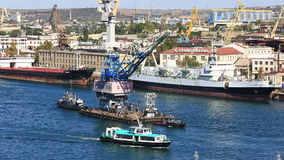 Two ships tow the crane on the sea gulf. Sevastopol stock video