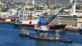 Two ships tow the crane on the sea gulf. Sevastopol stock footage