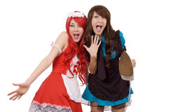 Two shocked servant girls with iron Royalty Free Stock Image