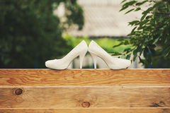 Two shoes on the fence. Wedding shoes white close-up for the most beautiful bride Royalty Free Stock Photos