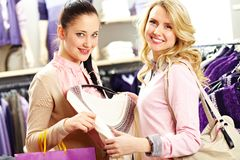 Two shopaholics Stock Photos