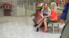 Two shopaholics having rest after good shopping in the mall.  stock video footage