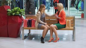 Two shopaholics having rest after good shopping in the mall.  stock footage