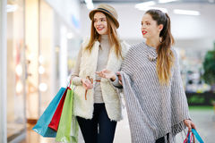 Two shopaholics Stock Images