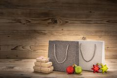 Two shopping bags with gifts and christmas decoration royalty free stock image
