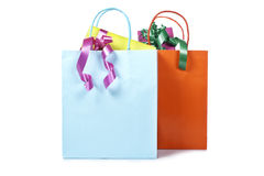 Two shopping bags with gifts inside stock photos
