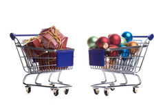Two shopping carts filled with christmas ornaments Stock Images