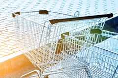 Two Shopping carts in a store parking lot Stock Images