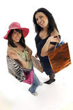 Two shopping girls Stock Photos