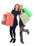 Two shopping women. Isolated on white background Stock Photos