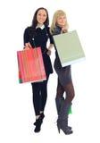 Two shopping women. Isolated on white background Royalty Free Stock Photos
