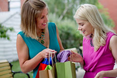 Two shopping women. Excited with their purchases Stock Image