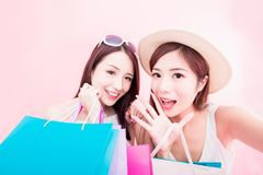 Two shopping woman selfie happily. Two shopping women selfie happily on the pink background stock images
