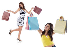 Two shopping young girls Royalty Free Stock Photos