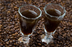 Two shot glasses of coffee liqueur, horizontal Stock Photo