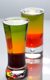 Two shot glasses with colorful cocktails Stock Photo