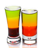 Two shot glasses with layered cocktails Royalty Free Stock Photography