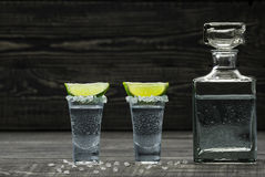 Two Shot Of  Cold Silver  Tequila A Black Wooden Background Royalty Free Stock Image