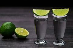 Two shot silver  tequila a black wooden background Stock Photography