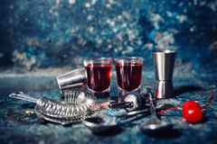 Two shots of cocktails. beverages with cherry and sweet hard liquor Stock Image