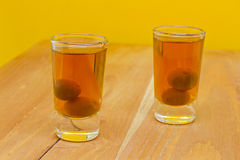 Two shots of homemade sloes liqueur Royalty Free Stock Photography
