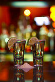 Two shots of tequila with lime and salt Stock Photography