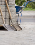 Two shovels at construction site Royalty Free Stock Images