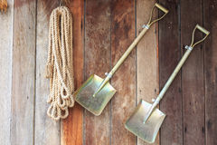Two shovels on vintage wooden wall Royalty Free Stock Photo
