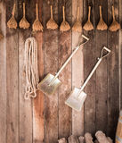 Two shovels on vintage wooden wall. Close up Two shovels of an old country house on vintage wooden wall stock photos