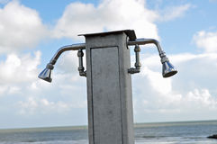 Two shower heads on beach Stock Photos